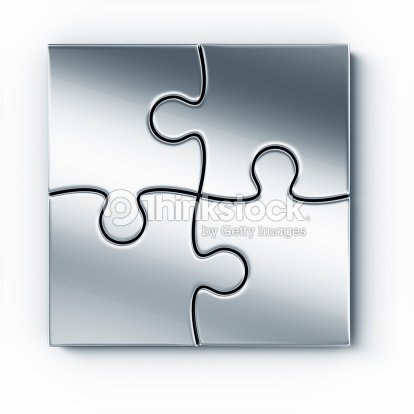 4 Pieces Of Metal Puzzle That Fit Together Perfectly Stock Photo