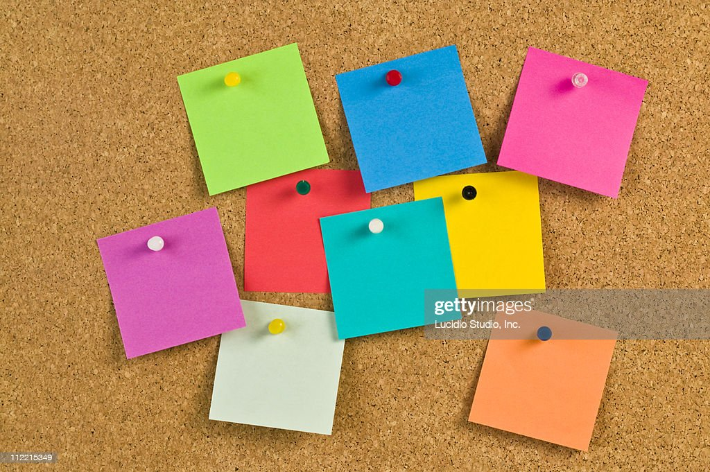Pieces of note paper on a cork bulletin board : Stock Photo
