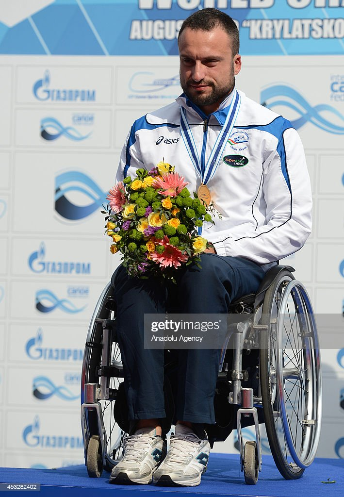 Pier Alberto Buccoliero of Italy poses with his gold medal after winning the men's V1 (LTA) 200m final of the 2014 ICF Canoe Sprint World hampionships in Moscow, Russia on August 6, 2014.