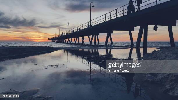 Pier At Beach Against Sky During Sunset