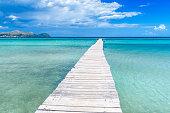 Pier at Playa Muro - beautiful coast and beach of Mallorca, balearic island of spain