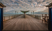 This is Boscombe pier in Dorset United kingdom. as the sun was setting it light up the pier like a 1960's stage show was about to be performed.