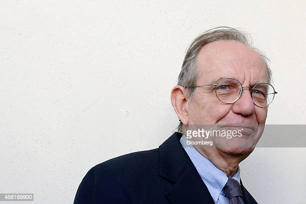 Pier Carlo Padoan Italy's finance minister arrives ahead of an event to mark World Savings Day at the Italian Banking Association in Rome Italy on...