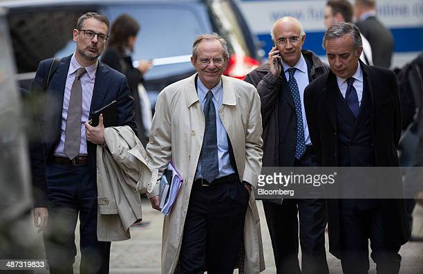 Pier Carlo Padoan Italy's finance minister center arrives for a speech at the London School of Economics in London United Kingdom on Tuesday April 29...