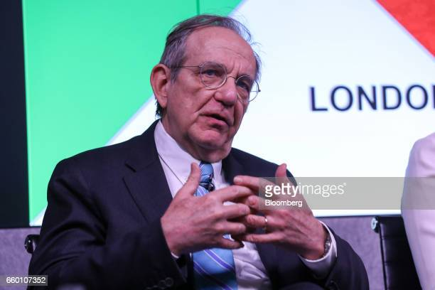 Pier Carlo Padoan Italy's finance minister gestures while speaking during a panel discussion on the topic of 'Italy Now and Next' in London UK on...