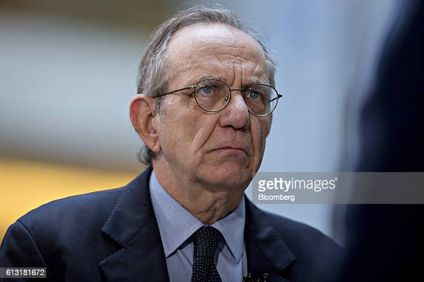 Pier Carlo Padoan Italy's finance minister listens during a Bloomberg Television interview at the International Monetary Fund and World Bank Group...
