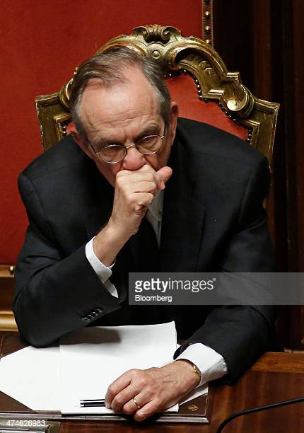 Pier Carlo Padoan Italy's finance minister listens during a parliamentary session inside the Senate the upper house of parliament in Rome Italy on...