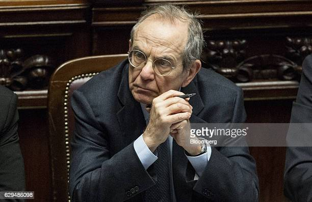 Pier Carlo Padoan Italy's finance minister listens during a parliamentary session inside the Chamber of Deputies the lower house of parliament ahead...