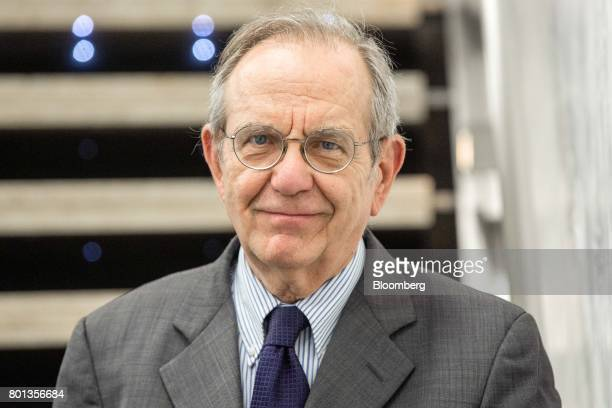 Pier Carlo Padoan Italy's finance minister poses for a photograph following a Bloomberg Television interview in Rome Italy on Monday June 26 2017...