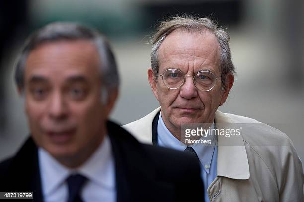 Pier Carlo Padoan Italy's finance minister right arrives for a speech at the London School of Economics in London United Kingdom on Tuesday April 29...