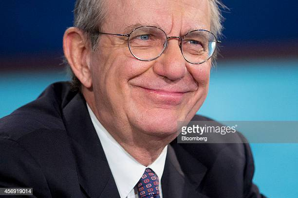 Pier Carlo Padoan Italy's finance minister smiles at a panel discussion during the International Monetary Fund and World Bank Group Annual Meetings...