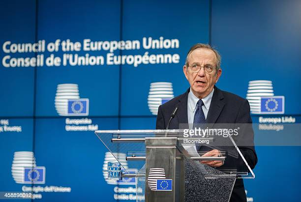 Pier Carlo Padoan Italy's finance minister speaks during a news conference following an Ecofin meeting in Brussels Belgium on Friday Nov 7 2014 A Dec...