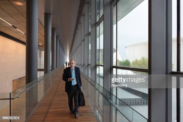 Pier Carlo Padoan Italy's finance minister walks along a corridor as he arrives for a Eurogroup meeting of European finance ministers in Luxembourg...