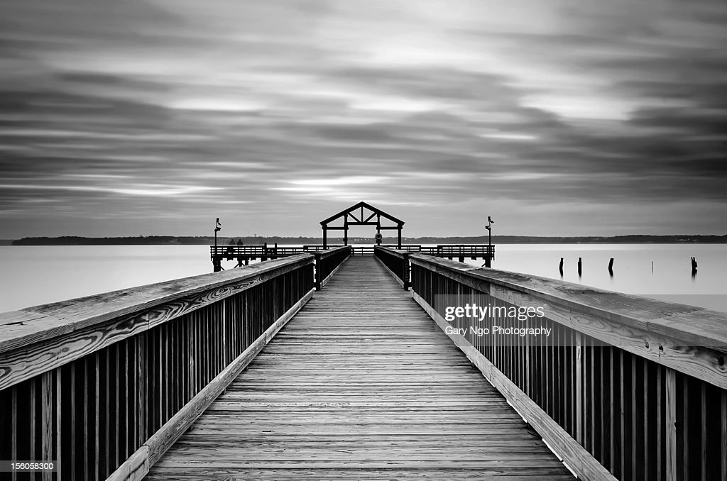 Pier in black & white in cloudy morning