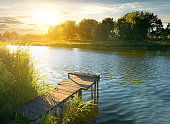 Wooden pier on a river in evening