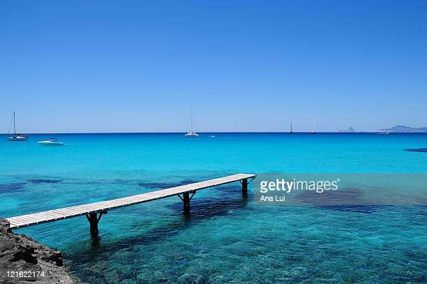 Pier in Formentera super blue sea