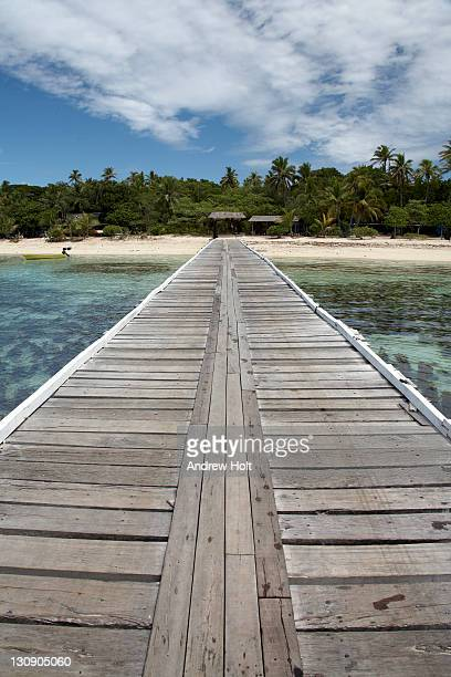 Pier in sea of tropical island