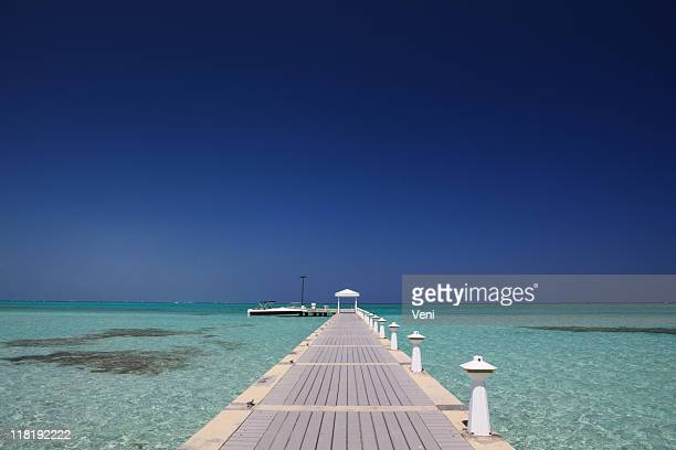 Pier in the clear waters of the Cayman Islands