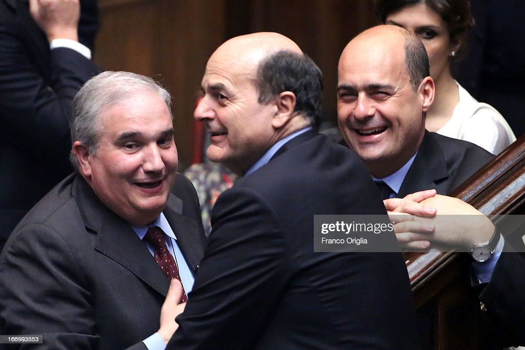 Pier Luigi Bersani (C) leader of Democratic Party smiles as Parliament elects a new President of Republic on April 19, 2013 in Rome, Italy. More than 1,000 politicians are due to gather in the lower house of parliament for the second day to vote in a successor for Giorgio Napolitano.