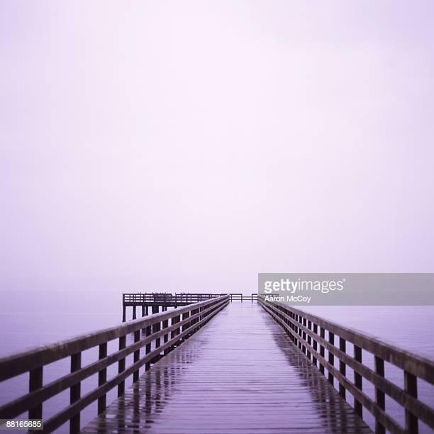 Pier on gloomy sea