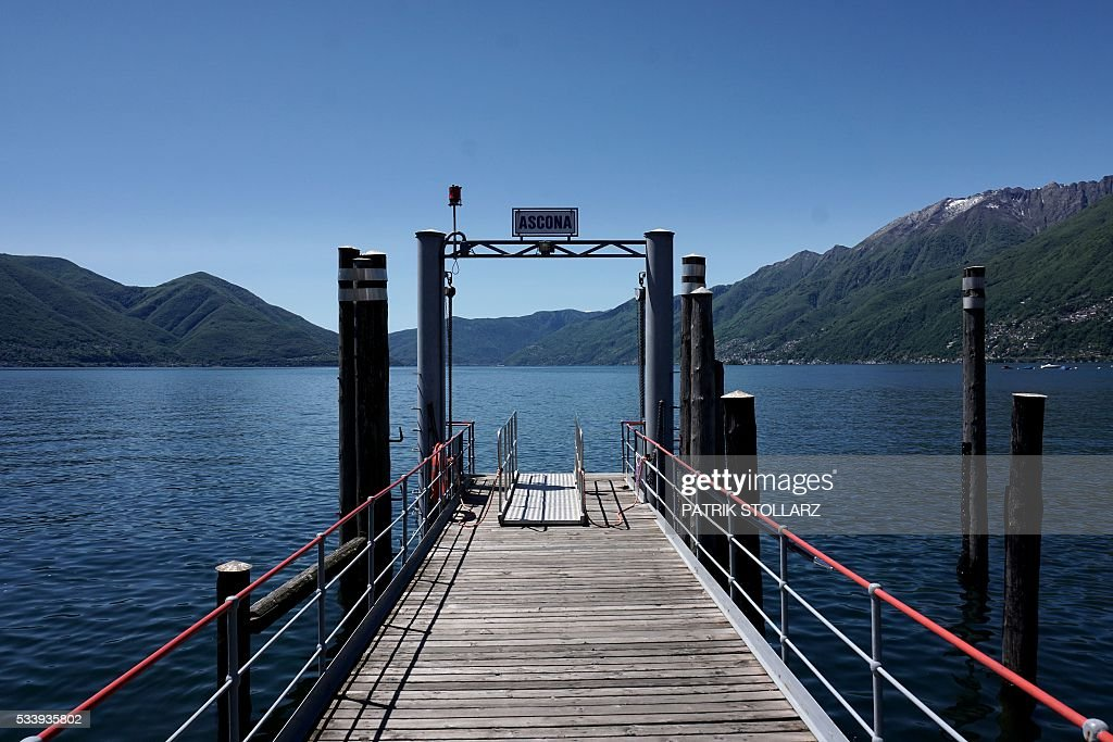 A pier on Lago Maggiore also called Lake Langen leads to the town of Ascona on May 24, 2016. The German national football team will train here from May 24 until June 3, 2016 for the EURO 2016 taking place in France. / AFP / PATRIK