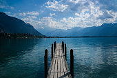 Old pier on the water of Lake Geneva in Switzerland.
