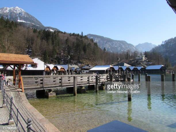 Pier On River With Mountain In Background