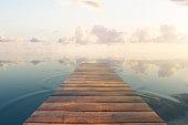 Wooden plank sea pier on beautiful sky background. 3D Rendering