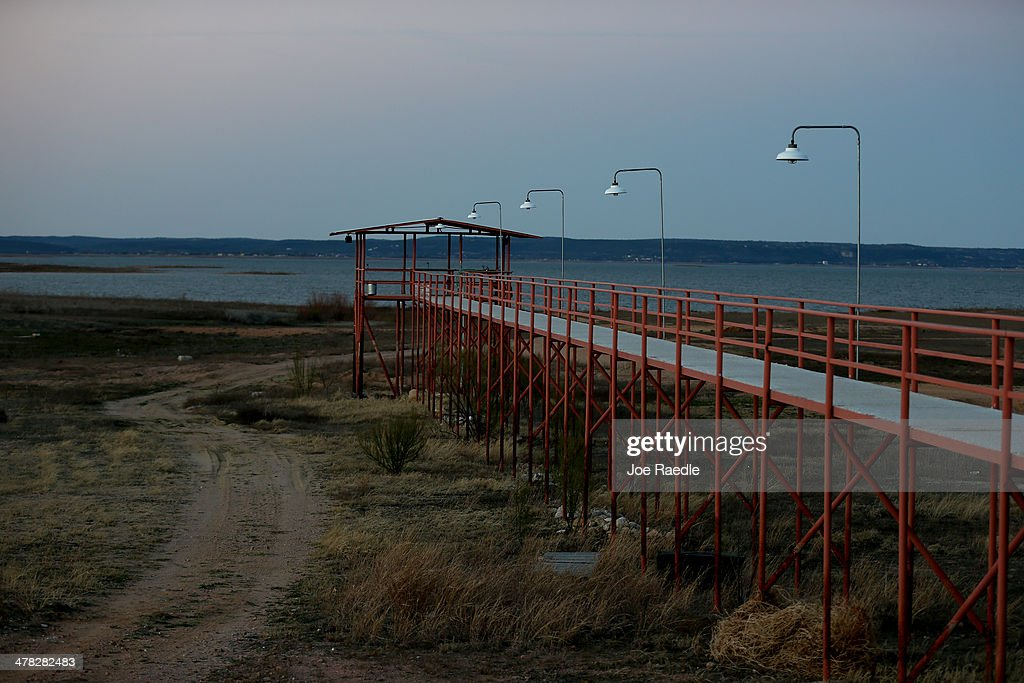 A pier once surrounded by the water of Lake Buchanan is seen afflicted by a severe drought on March 12, 2014 in Burnet, Texas. Farmers downstream and people living on the lakes are trying to figure out the best way to deal with the drought and water control. Recently the Texas Commission on Environmental Quality agreed to cut off water deliveries to most rice farmers in the Lower Colorado River Basin for the third straight year as the lakes in central Texas are only 38 percent full.