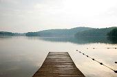 Pier onto calm lake, Bear Mountain, NY, USA