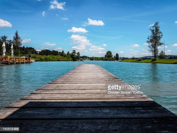 Pier Over Lake Against Sky