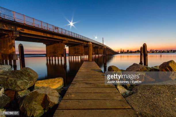 Pier Over River Against Clear Sky