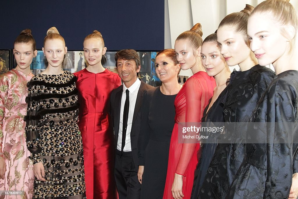 <a gi-track='captionPersonalityLinkClicked' href=/galleries/search?phrase=Pier+Paolo+Piccioli&family=editorial&specificpeople=5551258 ng-click='$event.stopPropagation()'>Pier Paolo Piccioli</a> and <a gi-track='captionPersonalityLinkClicked' href=/galleries/search?phrase=Maria+Grazia+Chiuri&family=editorial&specificpeople=5551257 ng-click='$event.stopPropagation()'>Maria Grazia Chiuri</a> pose with models as they attend the Valentino Haute-Couture Show as part of Paris Fashion Week Fall / Winter 2013 at Hotel Salomon de Rothschild on July 4, 2012 in Paris, France.
