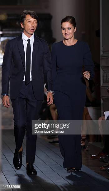 Pier Paolo Piccioli and Maria Grazia Chiuri walk the runway during the Valentino HauteCouture Show as part of Paris Fashion Week Fall / Winter...
