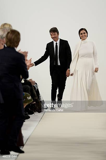Pier Paolo Piccioli and Maria Grazia Chiuri walk the runway during the Valentino Sala Bianca 945 Event at The Former Whitney Museum on December 10...