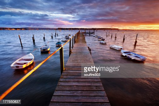 Pier view of the Poole harbor at sunset : Stock Photo