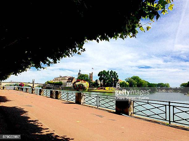 Pier With Tree Shadow By River