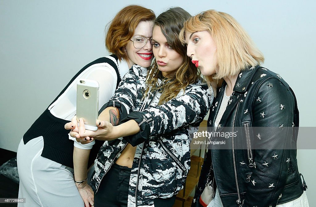 Piera Gelardi Tove Lo and Christene Barberich attend the Tove Lo Special Performance at Banana Republic Flatiron Flagship Store on March 26 2015 in...