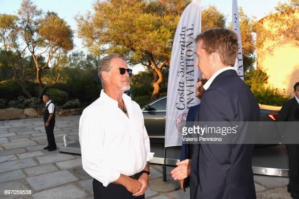 Pierce Brosnan and Jamie Cunningham arrive at The Costa Smeralda Invitational Gala Dinner at Cala di Volpe Hotel Costa Smeralda on June 17 2017 in...