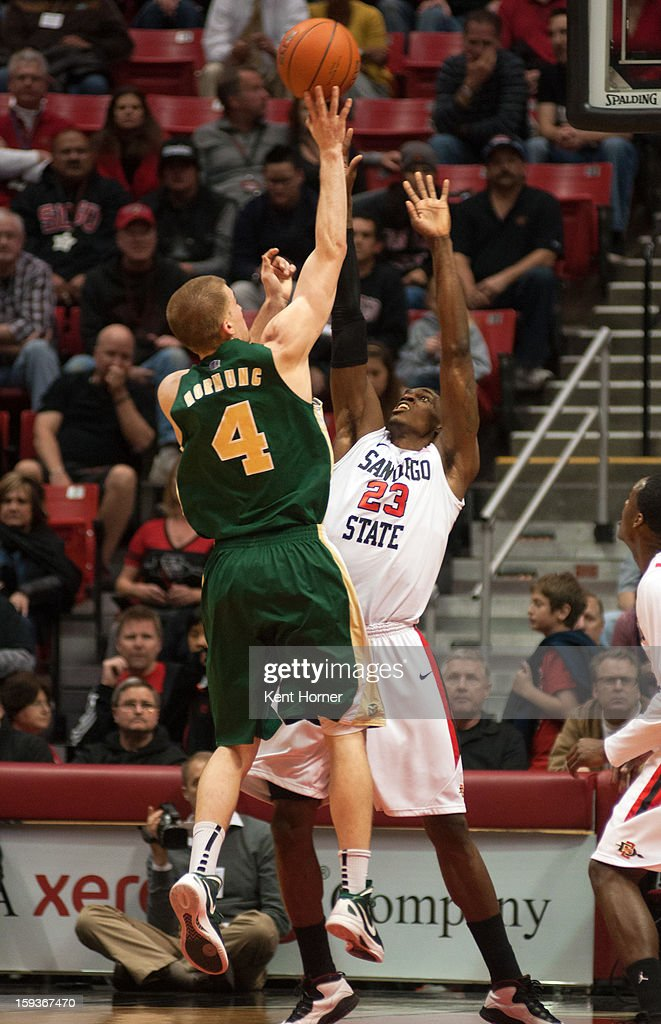 Pierce Hornung #4 of the Colorado State Rams shoots the ball in the first half of the game over Deshawn Stevens #23 of the San Diego State Aztecs at Viejas Arena on January 12, 2013 in San Diego, California.