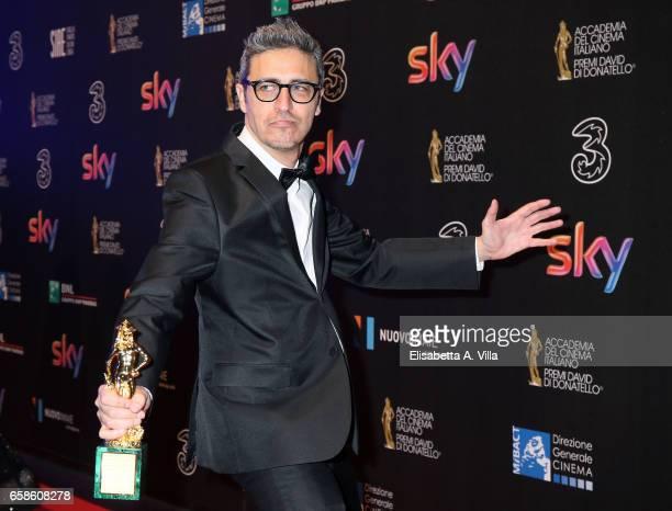 Pierfrancesco Diliberto aka Pif poses with his 'David Giovani' Award during the 61 David Di Donatello ceremony on March 27 2017 in Rome Italy