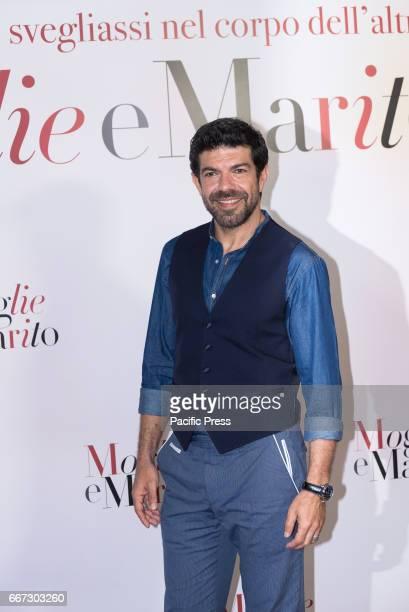 Pierfrancesco Favino attends a photocall for 'Moglie E Marito'