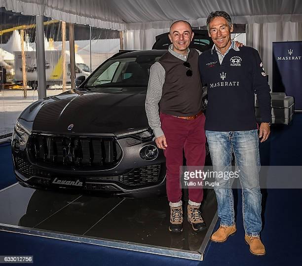 Piergiorgio Cecco CEO Maserati Switzerland and Achim Saurer Maserati Managing Director pose near a Maserati Levante during Snow Polo World Cup St...