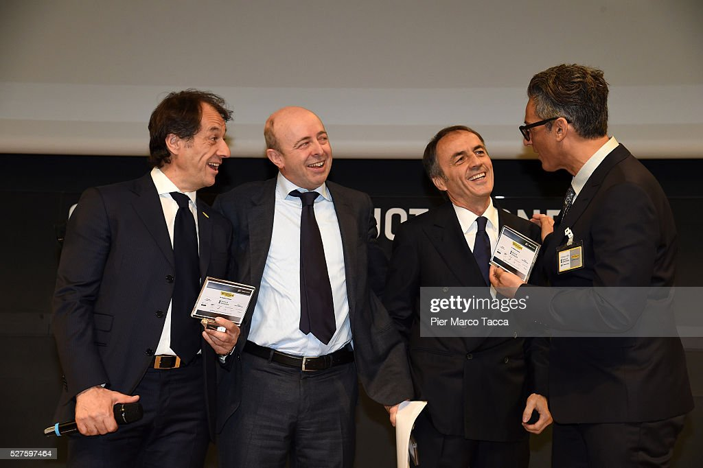 Pierluigi Alessandri, CEO of Borsa Italiana Raffaele Jerusalmi, <a gi-track='captionPersonalityLinkClicked' href=/galleries/search?phrase=Nerio+Alessandri&family=editorial&specificpeople=4607198 ng-click='$event.stopPropagation()'>Nerio Alessandri</a> and <a gi-track='captionPersonalityLinkClicked' href=/galleries/search?phrase=Rosario+Fiorello&family=editorial&specificpeople=2082907 ng-click='$event.stopPropagation()'>Rosario Fiorello</a> talk during the Technogym Listing Ceremony at Palazzo Mezzanotte on May 3, 2016 in Milan, Italy. Technogym is the world leader in the construction of equipment for gyms, founded in 1983 by <a gi-track='captionPersonalityLinkClicked' href=/galleries/search?phrase=Nerio+Alessandri&family=editorial&specificpeople=4607198 ng-click='$event.stopPropagation()'>Nerio Alessandri</a>, and was listed today on the Milan Stock Exchange.
