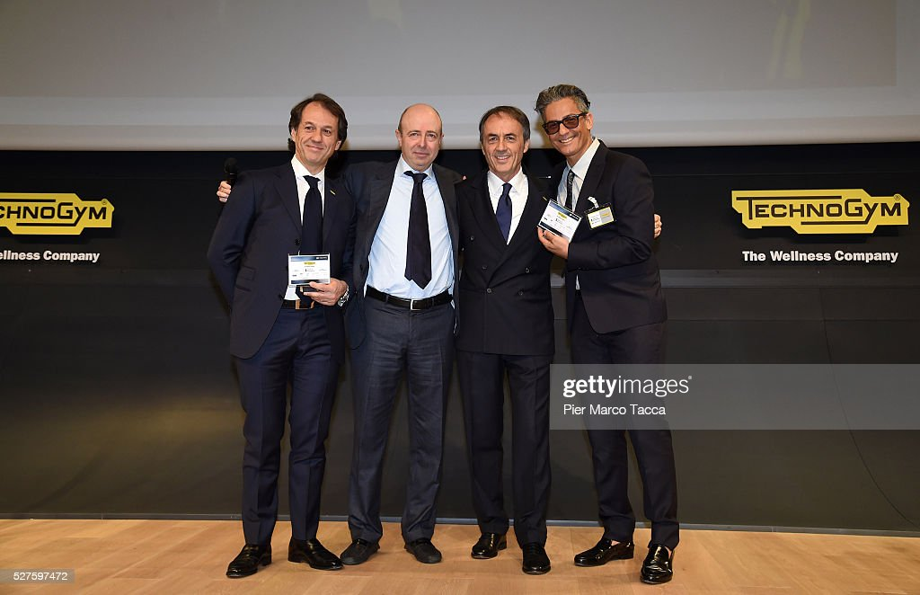 Pierluigi Alessandri, CEO of Borsa Italiana Raffaele Jerusalmi, <a gi-track='captionPersonalityLinkClicked' href=/galleries/search?phrase=Nerio+Alessandri&family=editorial&specificpeople=4607198 ng-click='$event.stopPropagation()'>Nerio Alessandri</a> and <a gi-track='captionPersonalityLinkClicked' href=/galleries/search?phrase=Rosario+Fiorello&family=editorial&specificpeople=2082907 ng-click='$event.stopPropagation()'>Rosario Fiorello</a> pose for a photo during the Technogym Listing Ceremony at Palazzo Mezzanotte on May 3, 2016 in Milan, Italy. Technogym is the world leader in the construction of equipment for gyms, founded in 1983 by <a gi-track='captionPersonalityLinkClicked' href=/galleries/search?phrase=Nerio+Alessandri&family=editorial&specificpeople=4607198 ng-click='$event.stopPropagation()'>Nerio Alessandri</a>, and was listed today on the Milan Stock Exchange.