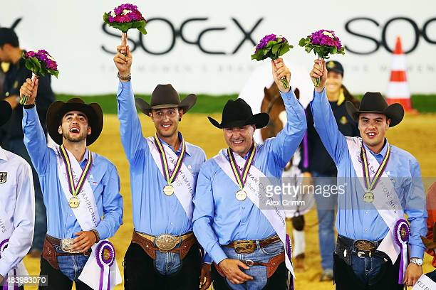 Pierluigi Fabbri Francesco Martinotti Giovanni Masi de Vargas and Edoardo Bernadelli of Italy celebrate winning the Reining team competition on Day 3...