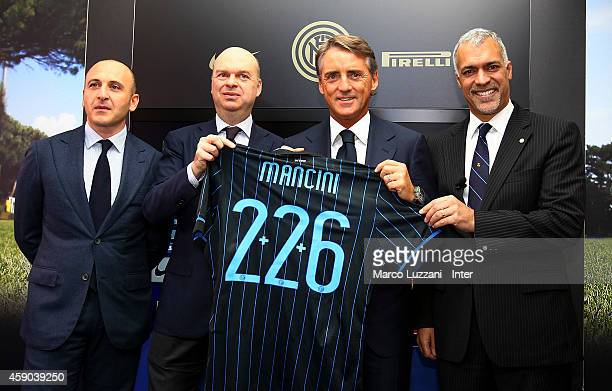 Piero Ausilio Marco Fassone new coach of FC Internazionale Milano Roberto Mancini and Michael Bolingbroke during a press conference at the club's...