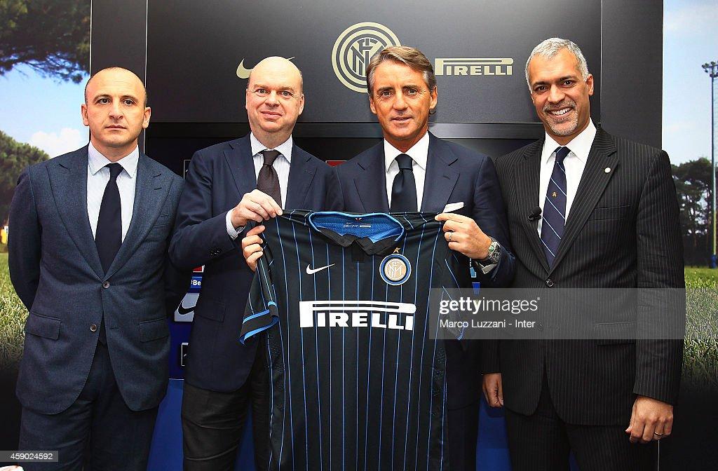 Piero Ausilio, Marco Fassone,New coach of FC Internazionale Milano Roberto Mancini and Michael Bolingbroke during a press conference at the club's training ground on November 15, 2014 in Appiano Gentile Como, Italy.