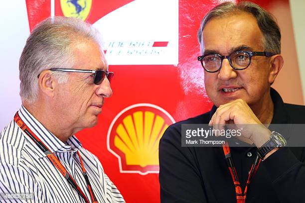 Piero Ferrari speaks with Fiat CEO Sergio Marchionne in the Ferrari garage during final practice for the Formula One Grand Prix of Italy at Autodromo...
