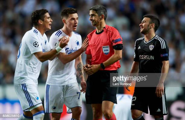 Pieros Sotiriou and Benjamin Verbic of FC Copenhagen shows frustration against Referee Alberto Undiano Mallenco of Spain after the UEFA Champions...